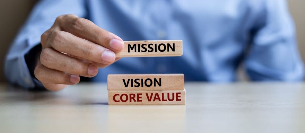The words mission vision and core values on building blocks